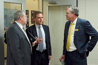 Nathan Romans | Argonaut Dean of the College of Science Paul Joyce, left, Chief Communications and Legislative Affairs Officer of the Idaho State Board of Education Blake Youde, center, and University of Idaho President Chuck Staben speak with each other after the conclusion of the National Institutes of Health grant announcement in the Mines building.