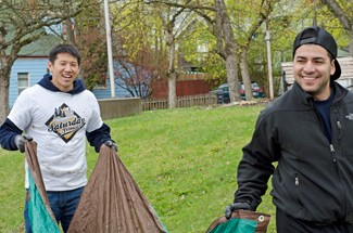 """Nathan Romans   Argonaut Mechanical engineering major Woovin Yi, left, and volunteer Juan Mexa carry leaves raked from the yard of the McConnell Mansion Saturday during """"Saturday of Service,"""" which is sponsored by the Center for Volunteerism and Social Action."""