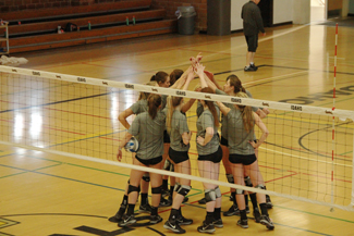 The Idaho volleyball team huddles during practice Wednesday in Memorial Gym. Sophomore middle blocker Torrin Crawford is stepping into a leadership position on the team this spring after the departure of middle blockers Stephanie Hagins and Alyssa Schultz.