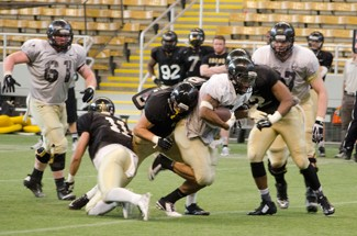 Freshman linebacker Kaden Elliss tackles Senior running back Elijhaa Penny during Idaho's second scrimmage Saturday in the Kibbie Dome. Elliss led the Vandals in tackles for the second straight scrimmage. The defense outperformed the offense for much of the day.
