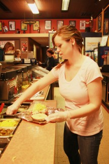 Maria Staab makes a bagel for a customer at the Moscow Bagel and Deli shop.