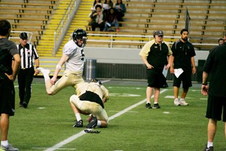 Nate Mattson | Argonaut   Junior Austin Rehkow kicks a field goal to put up an extra point during Friday night's Silver and Gold game at the Kibbie Dome.