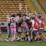 Teresa Patrick | Courtesy  The Idaho men's club lacrosse team huddles during its 14-8 Senior Day win over Washington State Sunday in the Kibbie Dome.
