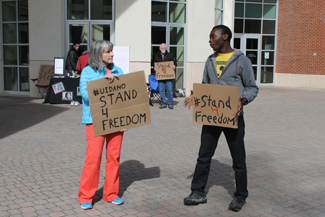 Genie Tran | Argonaut Muffy Minnich and David Afantchao stand outside the Idaho Commons Tuesday morning to help raise awareness about human trafficking.