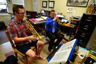 Amelia C. Warden   Rawr Music Professor Vern Sielert (right) and his student Nathan Top (left) practice in Vern's office on Tuesday afternoon in the Lionel Hampton School of Music.