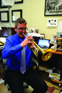 Amelia C. Warden   Rawr Music Professor Vern Sielert plays the trumpet in his office during a meeting with a student. Professor Sielert recently produced the jazz album Clarity with his band Unhinged Sextet.