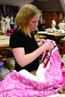 Amelia C. Warden | Rawr Krista Baker works on a garment in the fasion design studio. Students will show their garments at 8 p.m. this Saturday during the MoscowRade Wearable Art Fashion Show located in the Vandal Ballroom of the Bruce Pitman Center.