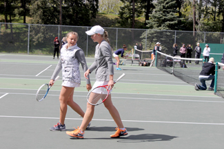 Irish Martos | Argonaut Sophomore Galina Bykova, left, and senior Emmie Marx chat during their doubles match Sunday at the Memorial Gym tennis courts. Bykova and Marx helped lead the Idaho women's tennis team to two dominating home victories over the weekend.
