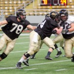 File photo by Nathan Romans | Argonaut  Former Idaho offensive linemen Jesse Davis, left, and Mike Marboe, center, clear the way on a running play during practice Nov. 12 in the Kibbie Dome. Davis and Marboe, along with former tight end Justin Podrabsky, all signed undrafted free agent deals with NFL teams over the weekend.