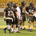 File photo by Nathan Romans | Argonaut  Senior linebacker Marc Millan, left, prepares for the next play during the first spring practice of the year March 25 in the Kibbie Dome.