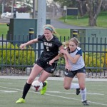 Freshman Defender Olivia Baggerly fights a Gonzaga opponent for the ball during Idaho's 1-1 tie with the Bulldogs March 28 on the SprinTurf. The Vandals had an up-and-down first season back in the Big Sky.