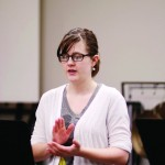 Tess Fox | Argonaut  Freshman Andrea Falk practices clapping and counting during Aural Skills 1 on Friday. Falk is a Cello and Vocal performance major.