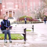 Tess Fox | Argonaut  Freshman Danielle Payne reads over notes for her classes outside the Teaching and Learning Center. Payne has branched out culturally and attended prayer at a mosque during her first semester.