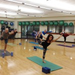 Corrin Bond | Rawr  A University of Idaho student yoga instructor leads her class through different types of poses.