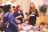 Yishan Chen | Argonaut  Sabrina Harris and Sara Nutsch (center) explain programs to Caila Zimmerman (left) at the Study Abroad Fair Wednesday.