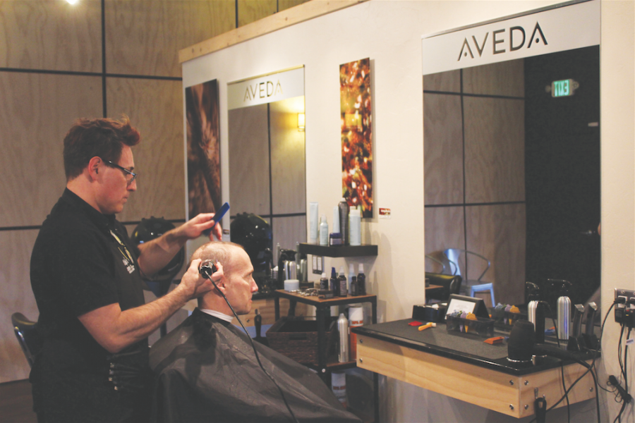 Austin Maas | Rawr Hair stylist Michael Woodall trims the hair of his partner Will Butler at Canopy Aveda Salon, located in downtown Moscow.