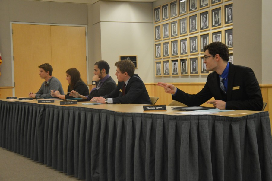 ASUI Senator Zachary Spence speaks at the ASUI meeting Wednesday. The ASUI senate amended a bill regarding spring election campaigning length.