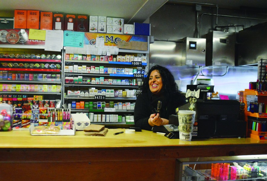 Alex Brizee | Rawr Farrukh Naz smiles as she interacts with students at her local business, The Perch.