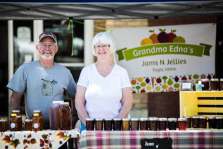 Nicholas Eastman-Pratt | Argonaut Business partners Craig Roberts and Edna Neer stand at the Moscow Farmers Market to sell their honey, jam and jelly.