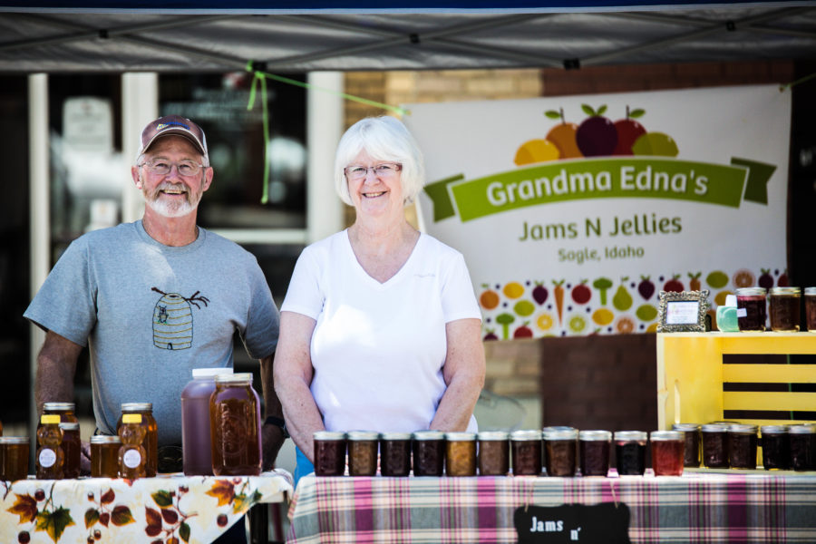 Business partners Craig Roberts and Edna Neer stand at the Moscow Farmers Market to sell their honey, jam and jelly.