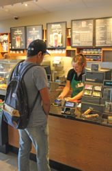Diamond Koloski | Argonaut Junior Jena Hinman works at Starbucks regularly while attending college.  -OR-  Junior Jena Hinman happily rings up an order for one of her many customers at the Starbucks on campus.