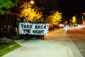 Joleen Evans | Argonaut Members of the UI community march through campus during Take Back the Night Thursday to take a stand against domestic violence.
