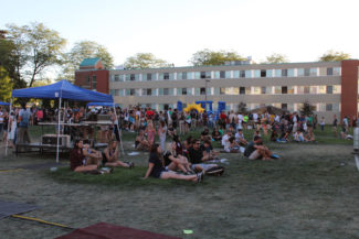 Diamond Koloski | Argonaut Students relax on the Tower Lawn during Palousafest on Saturday evening.
